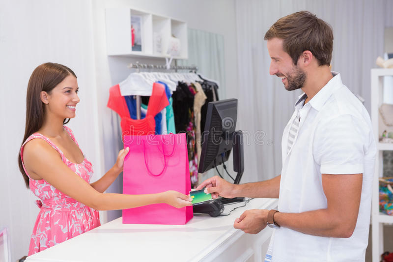 Cashier interacting with customer. At a boutique royalty free stock images
