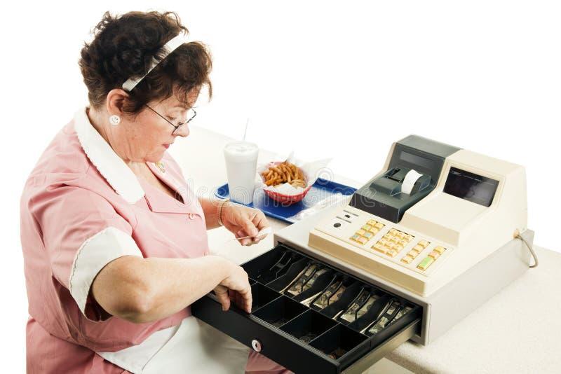 Cashier Makes Change stock image