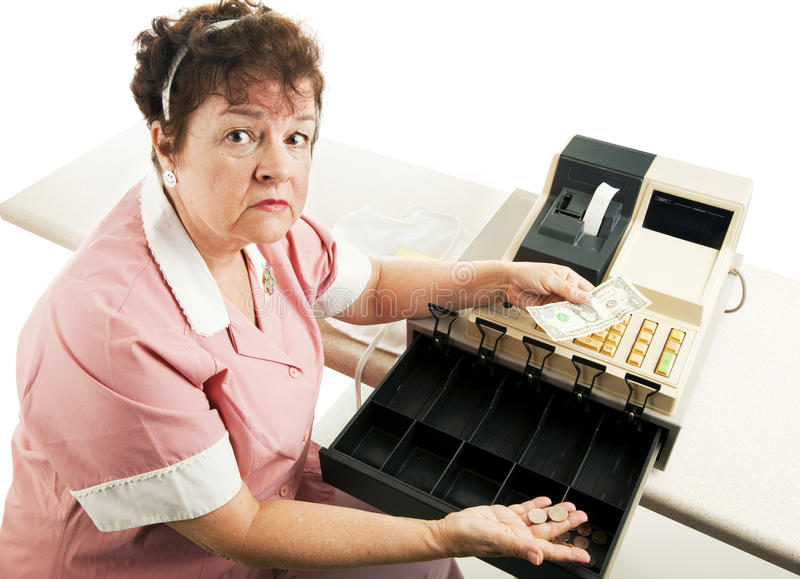 Cashier - Recession. Worried cashier with a nearly empty cash register. White background royalty free stock image