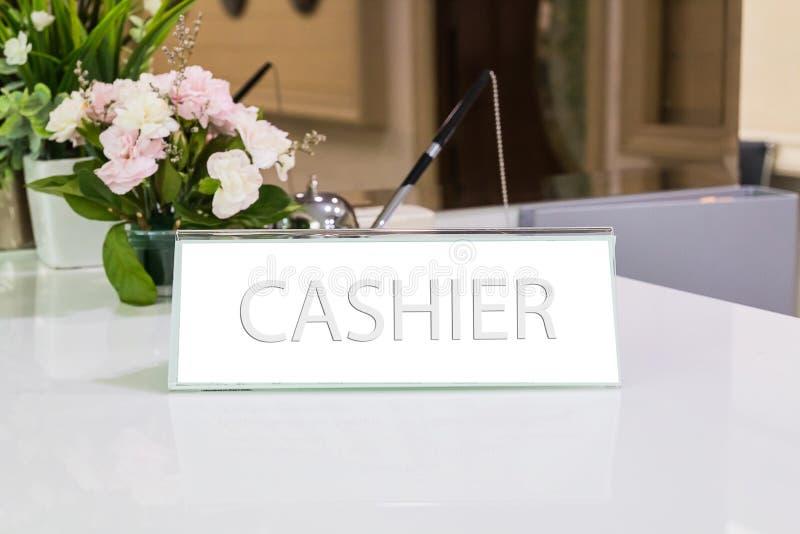 Cashier sign. On desk royalty free stock image