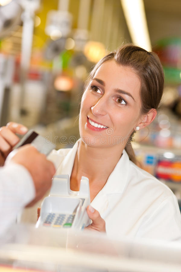 Download Cashier In Supermarket Taking Credit Card Stock Photo - Image: 15845342
