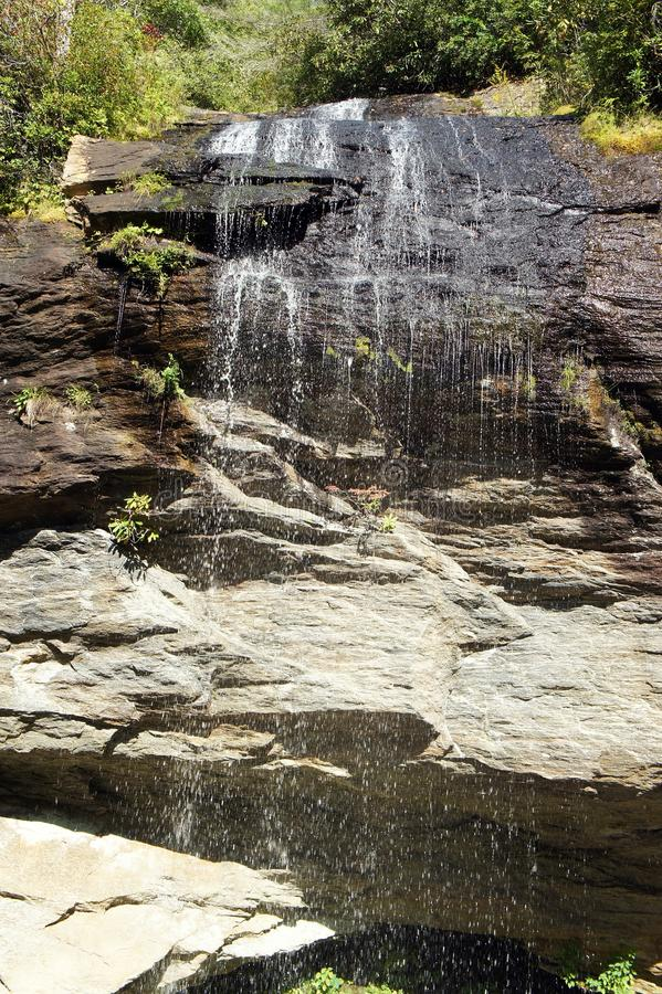 CASHIERS NORTH CAROLINA WATERFALL. View from below a small waterfall as water trickles down the rocks royalty free stock photography