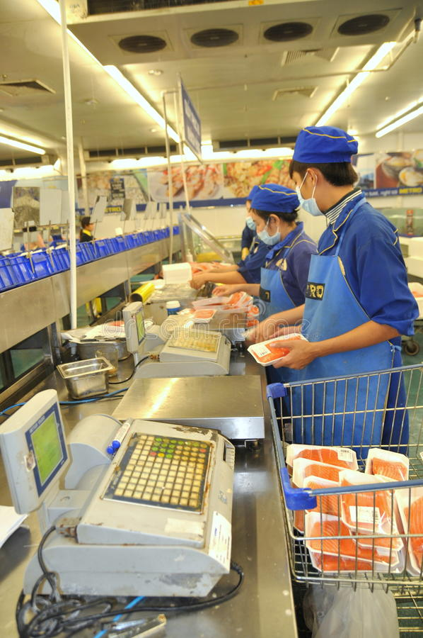 Cashiers are working hard in a seafood booths in a modern supermarket in Vietnam stock images