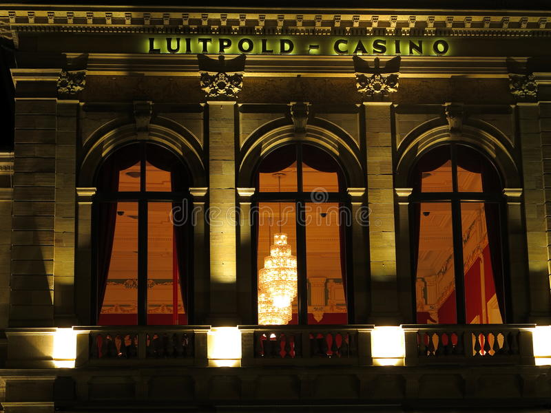 Casino building detail by night. A look through the window into the gambling hall of the Luitpold-Casino building (a landmark in the spa town Bad Kissingen stock photography