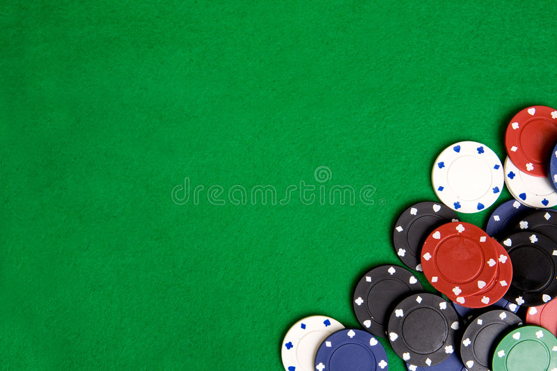Casino Chip Background. Casino chips on a green felt - background image royalty free stock photos