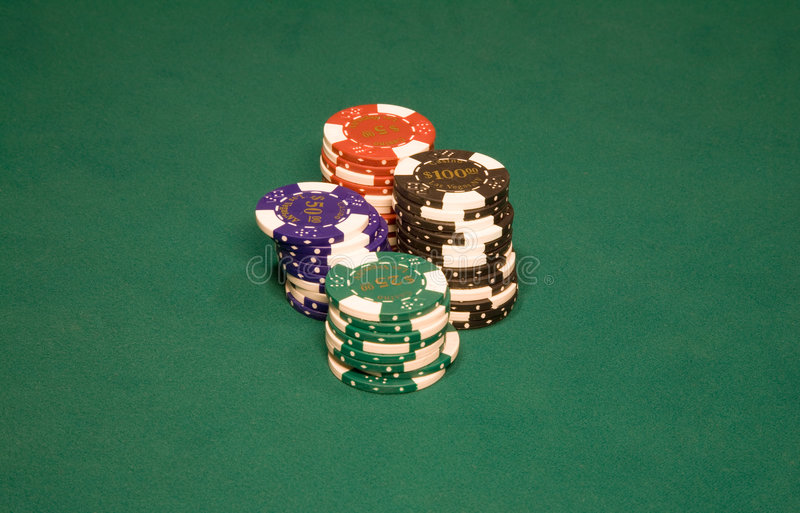Casino chips. On the green table in Vegas royalty free stock photo