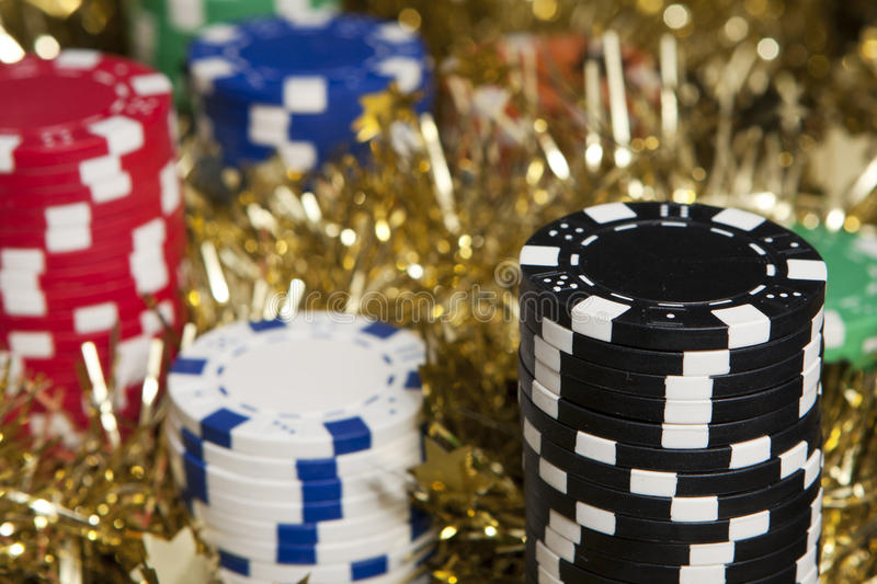Casino chips bonus. Photo taken in a worm Christmas light royalty free stock images