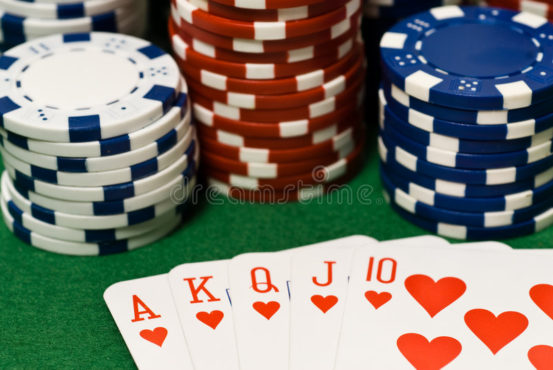 Casino chips and cards. Casino chips and cads on green stock photos