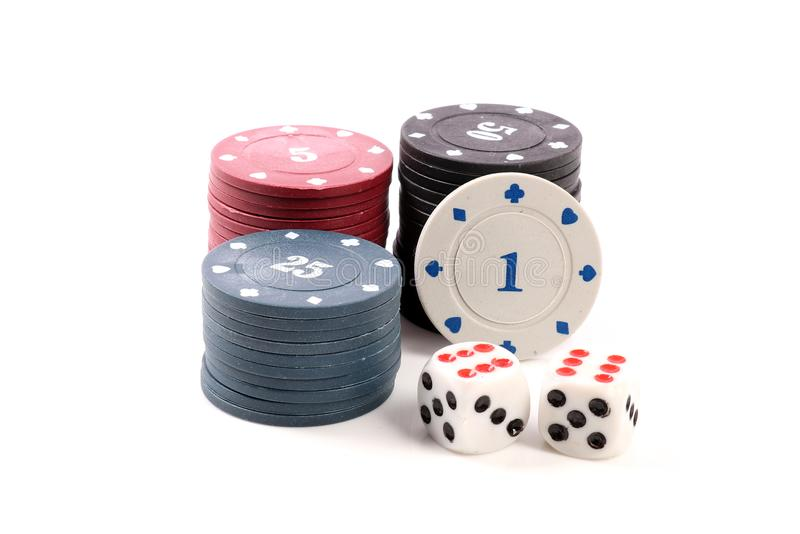 Casino chips and dice. Beautiful shot of casino chips and dice on white background royalty free stock photography