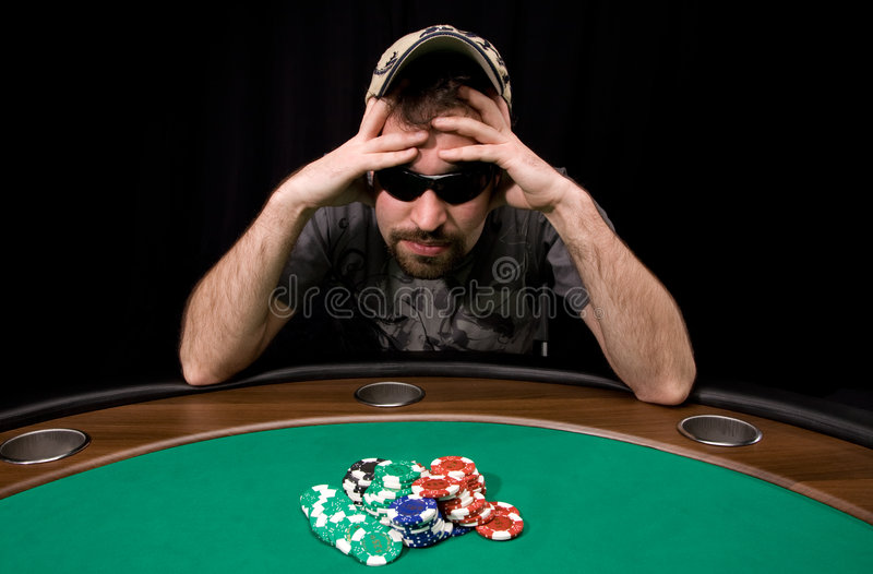 Casino chips on green felt. Caucasian man wins a lot of casino chips over black stock images