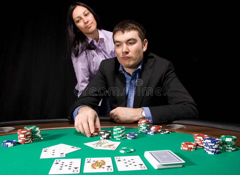 Casino Chips On Green Felt Stock Photos
