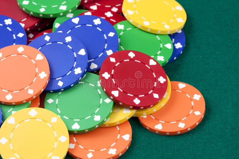 Casino chips, red, yellow, green, orange royalty free stock photography