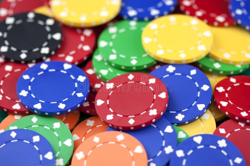 Casino chips, red, yellow, green, orange, black royalty free stock photo