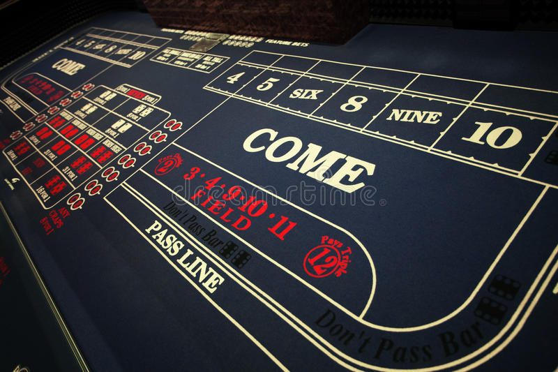 In casino. Close up view of blue surface of the gambling table royalty free stock photos