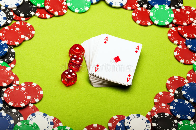 Casino concept. Shot in studio on green background stock photos