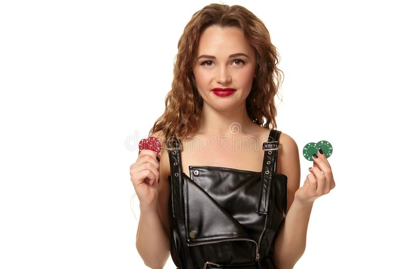 Casino concept. Portrait of young pretty caucasian woman, playing in casino. Roulette, poker chips, cards, wheel. Attractive young caucasian brunette woman in royalty free stock photos