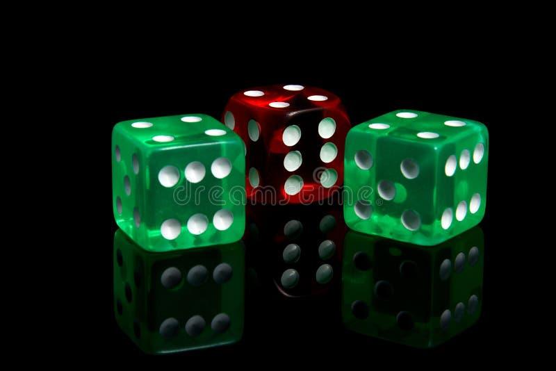 Casino dice. Three casino dice on a black background stock images