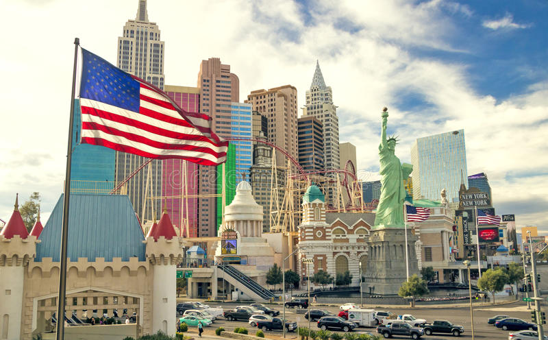 Casino and hotel New York New York along with Las Vegas strip and US flag fluttering. LAS VEGAS, NEVADA, USA - APRIL 27, 2017: Casino and hotel New York New York stock photos