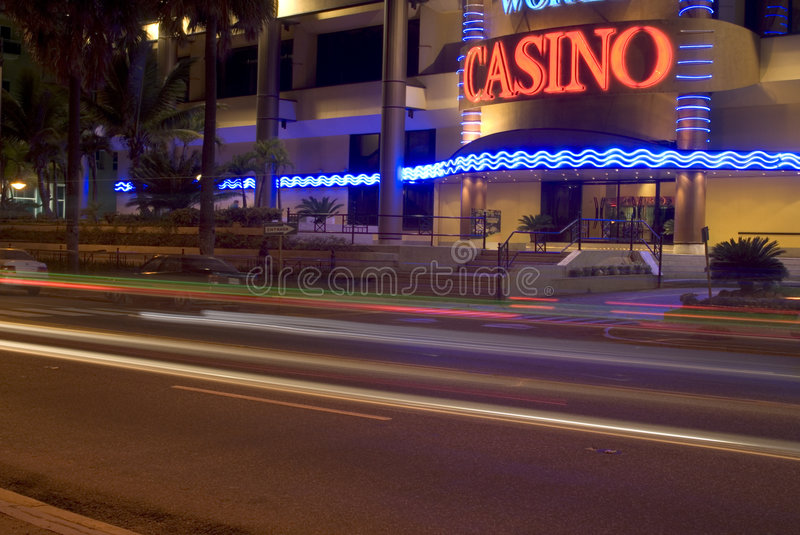 Casino with light streaks. Motion blur light streaks cars on malecon by casino santo domingo dominican republic stock images