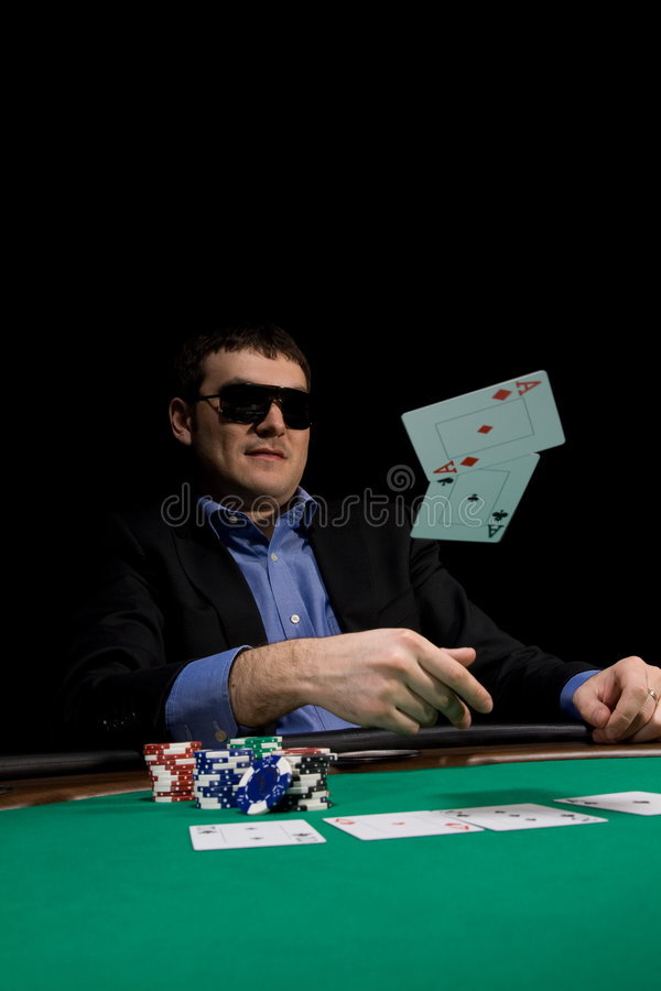 Casino poker. Flying cards in texas hold'em poker over green casino table royalty free stock images