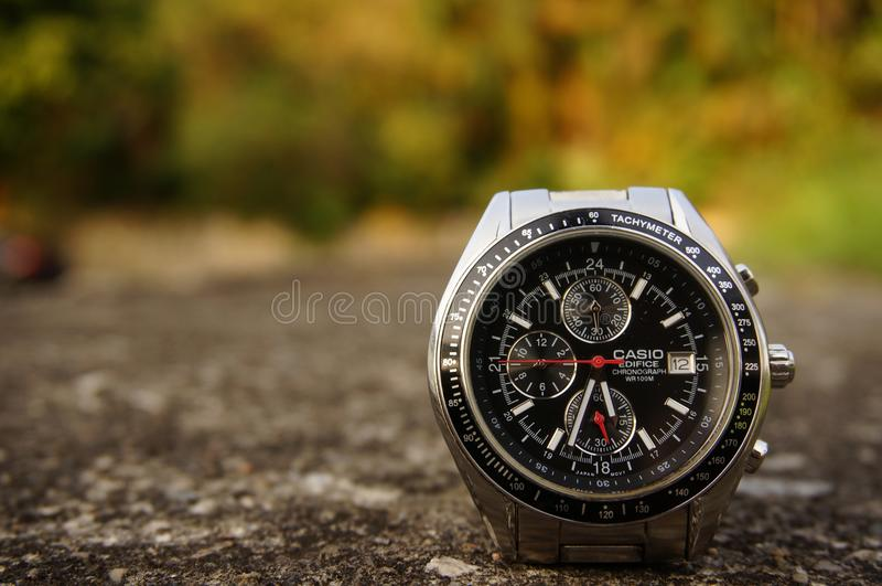 Casio watch on the ground outside royalty free stock photography