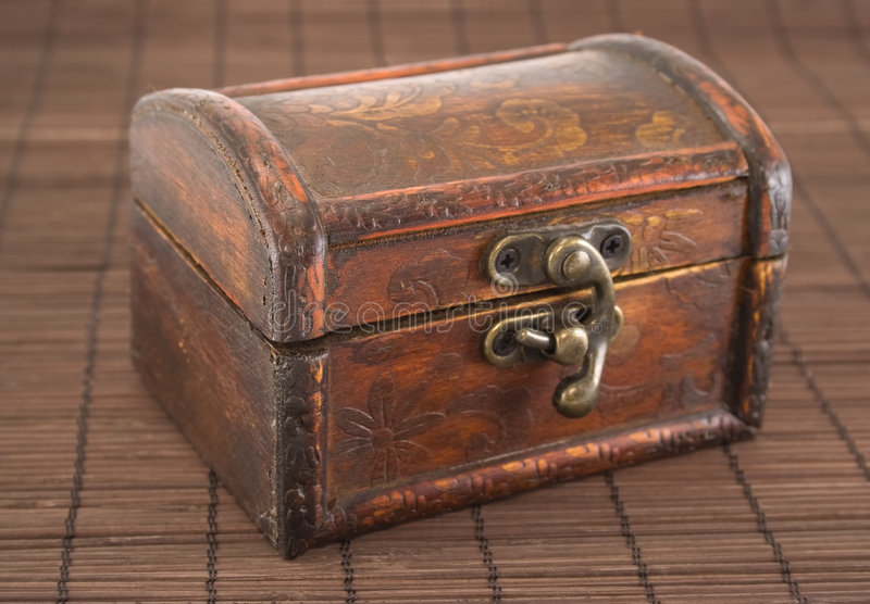 Casket. Wooden casket with iron lock stock image