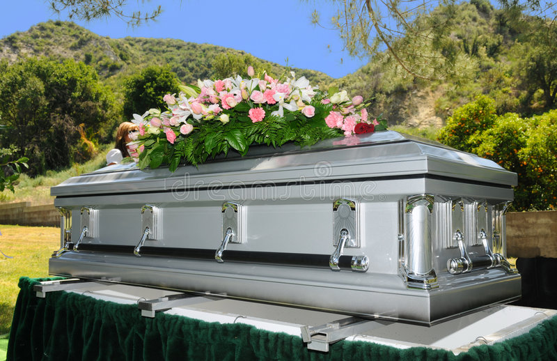 Casket. Image of a stainless steel Casket with Flowers royalty free stock images