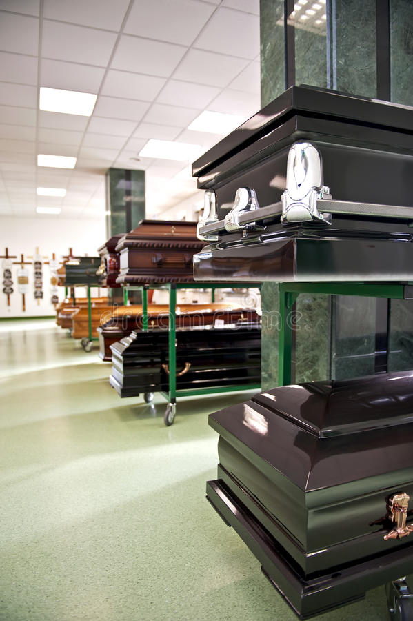 Casket store. Variuos caskets exposed in a casket store stock photography