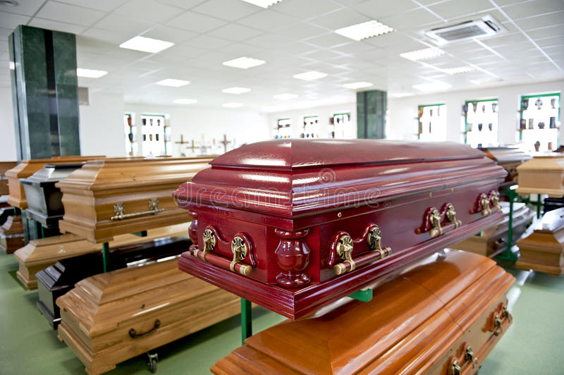 Casket store. Variuos caskets displayed in a casket store royalty free stock photos