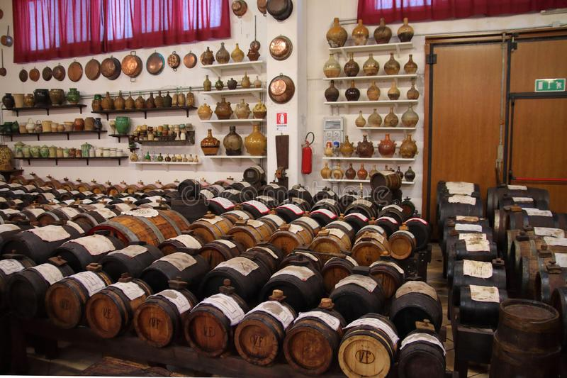 Casks for the procduction of original Balsamic vinegar in Castelnuovo di Modena. `Batteria` is a series of barrels of different kind of woods for the production royalty free stock images