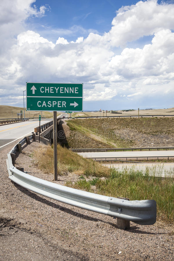 Casper direction sign. Roadside sign providing directions to Casper and Cheyenne, Wyoming along a rural Wyoming highway royalty free stock images