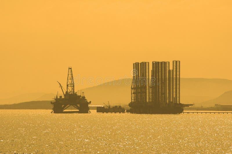 Caspi抽油装置日落 免版税库存照片