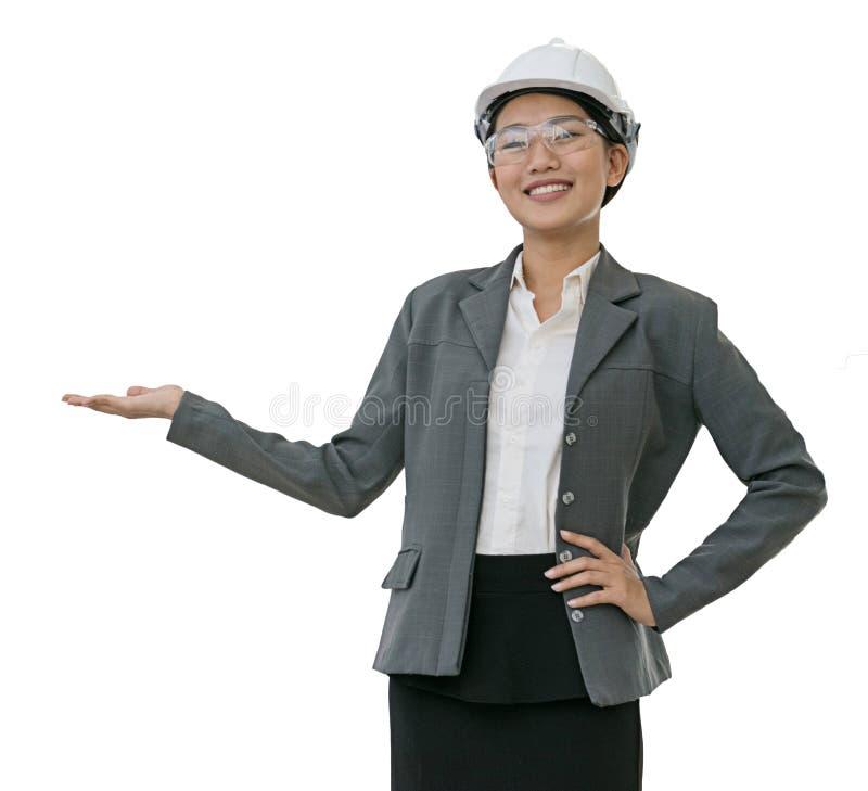 Casque blanc de port de femme d'affaires fond d'isolement avec le cli photographie stock libre de droits