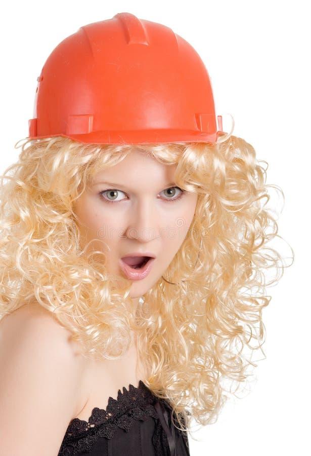 casque blond de construction image stock