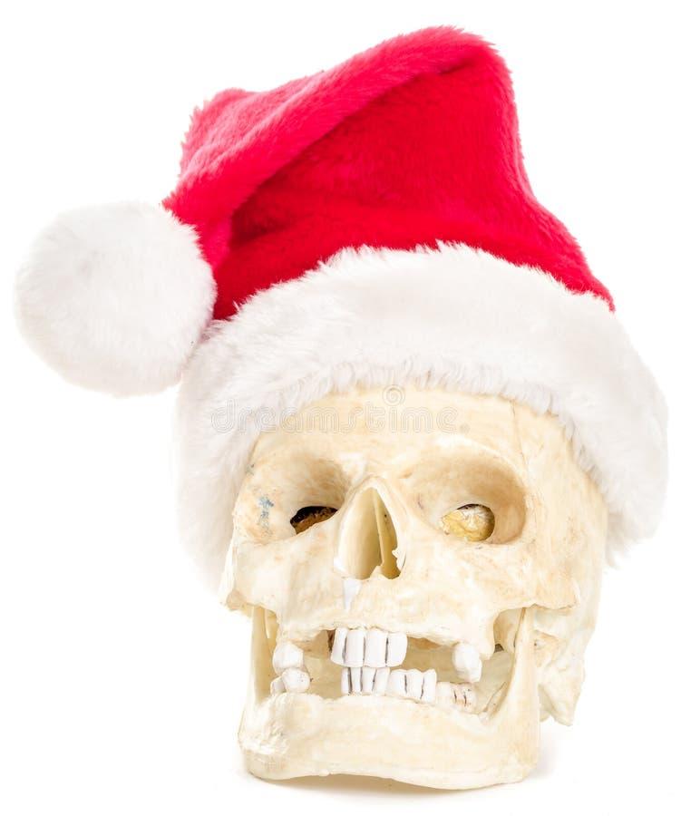 Casquillo de Papá Noel de la Navidad del cráneo que desgasta humano fotos de archivo libres de regalías