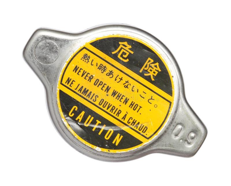 Casquillo de radiador con la escritura de la etiqueta amonestadora fotos de archivo
