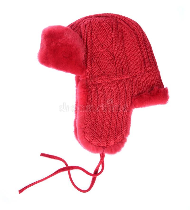 Casquillo rojo de la piel en un fondo blanco fotografía de archivo libre de regalías