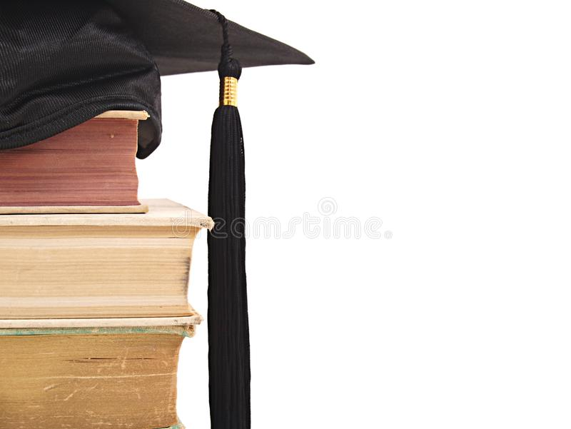 Casquillo y libros de la graduación fotos de archivo libres de regalías