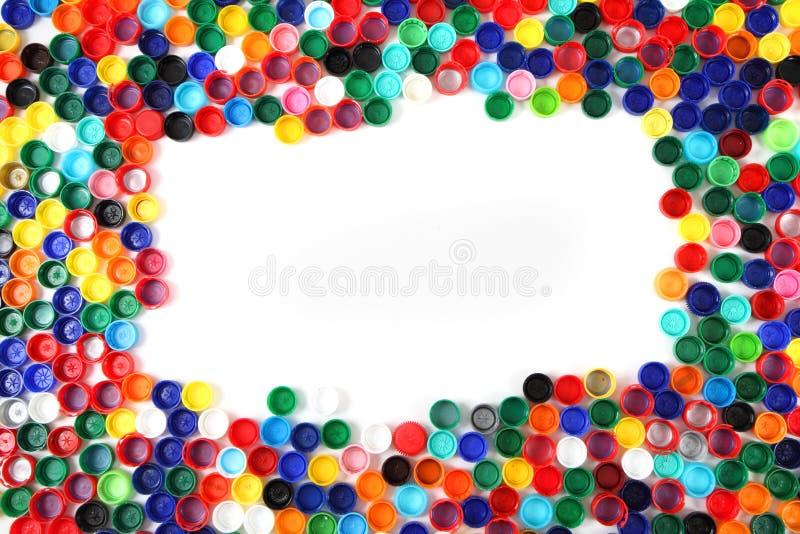 Casquillos del color como fondo plástico fotos de archivo libres de regalías