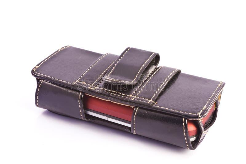 Cassa del telefono mobile su una priorità bassa bianca immagine stock