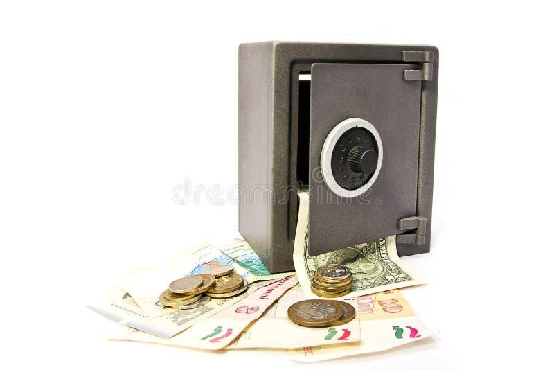 Cassaforte con soldi fotografie stock libere da diritti