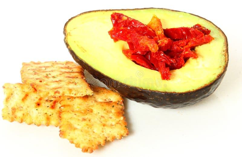Casse-croûte d'avocat et de tomate image stock