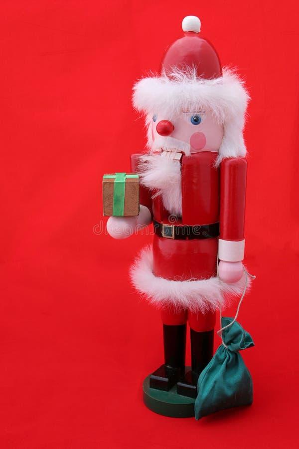Casse-noix de Santa sur le rouge photographie stock