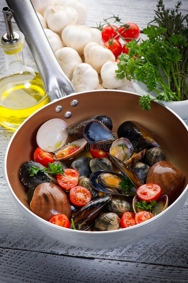 Casserole with mollusk stock image