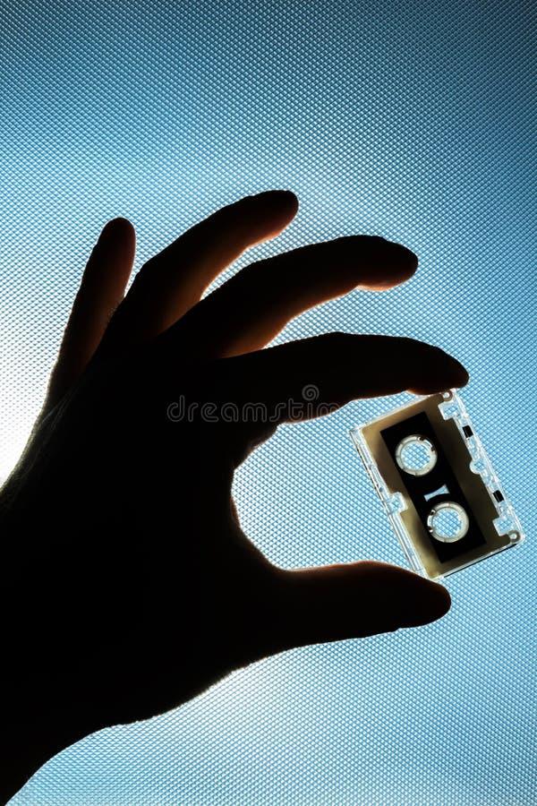 Cassete в руке стоковое изображение