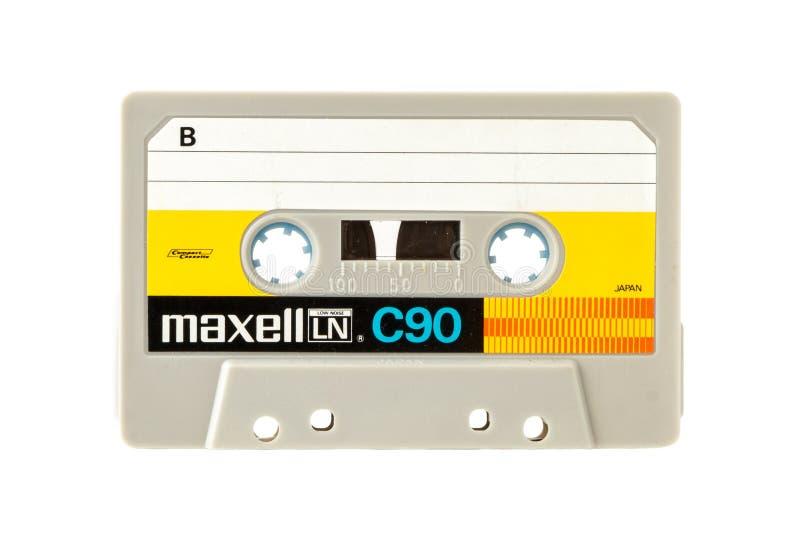 Cassete compacto audio de MAXELL isolado no fundo branco imagens de stock royalty free