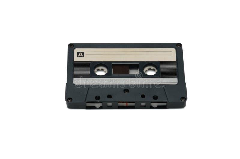 Cassette audio compatte per la registrazione magnetica su un fondo bianco Cassettte compatto fotografia stock libera da diritti