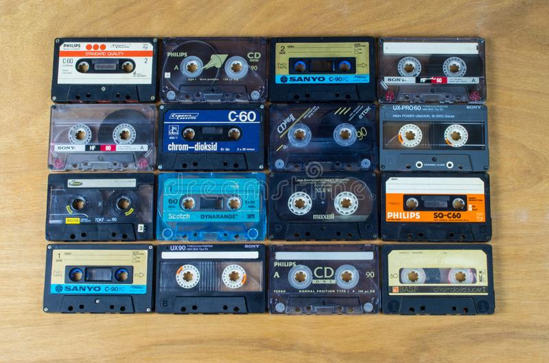 Cassette audio tapes on a wooden background royalty free stock photo