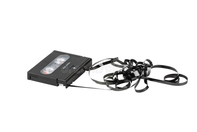 Cassette de DAT con la cinta enredada y torcida fotos de archivo libres de regalías