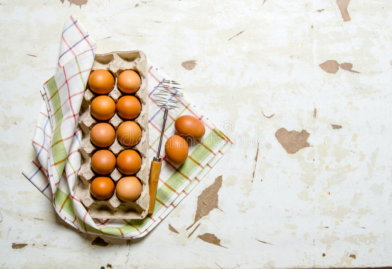 The cassette with eggs on the fabric . royalty free stock photography
